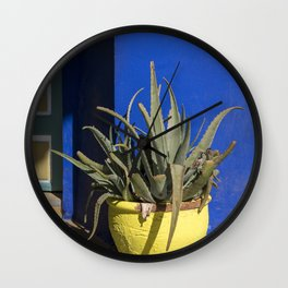 Yellow flower-pot and blue wall, Morocco Wall Clock