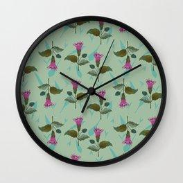 Datura flowers on a light blue grassy background Wall Clock