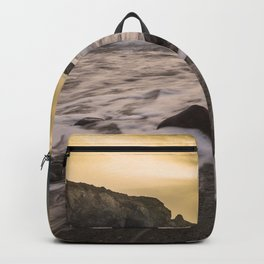 Beautiful Landscape of waves with sunset in black beach in iceland Backpack