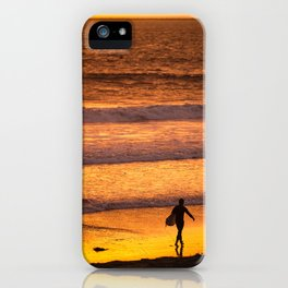 Surfer walking along beach at sunset iPhone Case
