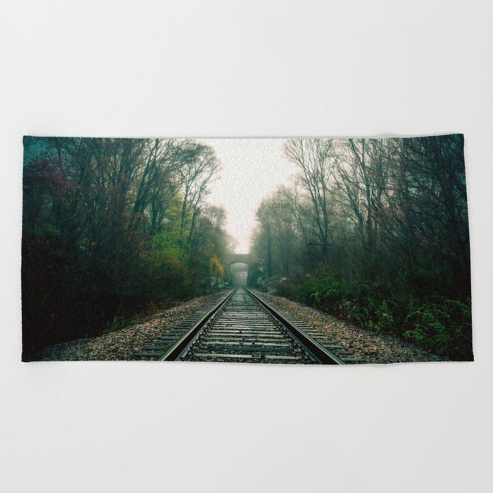 Creepy foggy railroad Beach Towel