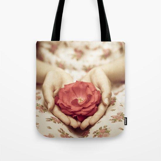 Rose in her hands II Tote Bag