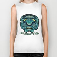 the cure Biker Tanks featuring No Cure For Ugly by Gene S Morgan