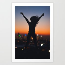 Woman silhouette jumping over sunset Art Print