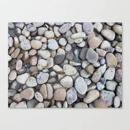 Small stones above the water Canvas Print