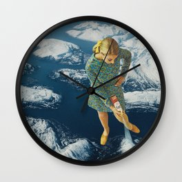 Spraying snow on the mountains Wall Clock