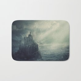 on the top of a cliff Bath Mat