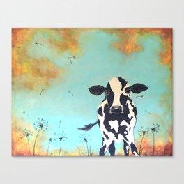 Cow in Dandelion field Canvas Print