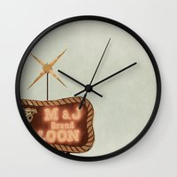 fargo Wall Clocks featuring Retro Saloon Sign by angela haugland
