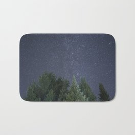 Pine trees with the northern michigan night sky Bath Mat