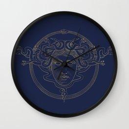 medusa / gold minimal line logo on navy background Wall Clock