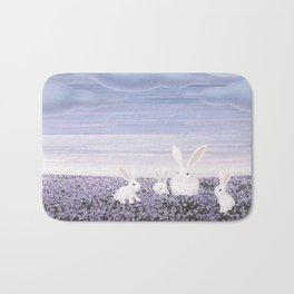 white rabbits and purple flowers Bath Mat