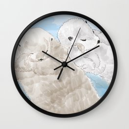 Otters hold hands Wall Clock
