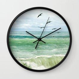 Birds flying above ocean Wall Clock
