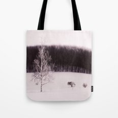 The forest behind the tree Tote Bag