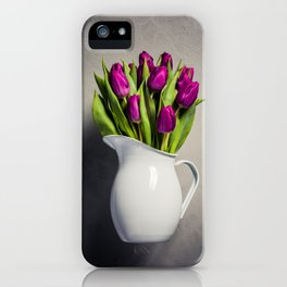 Levitating purple tulips against old concrete background iPhone Case