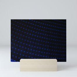 Abstract blue lights. Electricity in geometric form. Points that form patterns of lines on a black b Mini Art Print