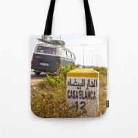 casablanca Tote Bags featuring Casablanca milestone with old Volkswagen microbus by Premium
