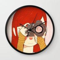 nan lawson Wall Clocks featuring Behind The Lens by Nan Lawson