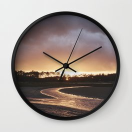 Storm clouds at sunset. Holkham, Norfolk, UK. Wall Clock