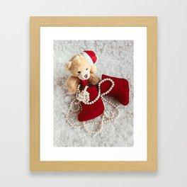 A soft bear toy on the snow background Framed Art Print