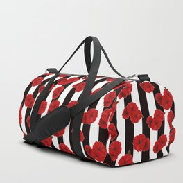 Red poppies on a black and white striped background. Duffle Bag