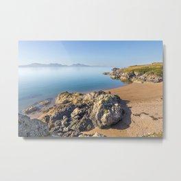 Volcanic rock and beach on Llanddwyn Island, Anglesey, Wales, Llyn peninsula in the background Metal Print