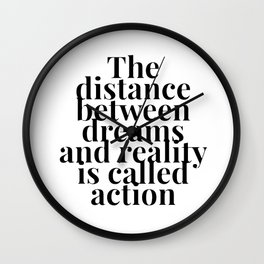 The distance between dreams and reality Wall Clock