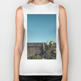 Yellow flowers over a wooden fence Biker Tank