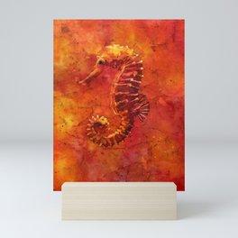 Watercolor batik painting of red seahorse swimming in fiery red orange ocean.  Nautical artwork sea Mini Art Print