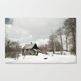 dilapidated wooden house cottage in winter Canvas Print