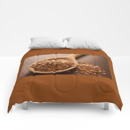 Brown flax seeds heap on wooden spoon Comforters