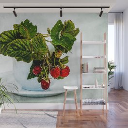 Fresh raspberries in a teacup Wall Mural