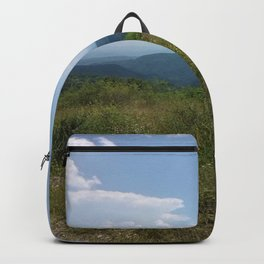 Meadow and mountains in the distance Backpack