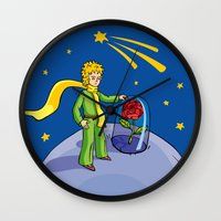the little prince Wall Clocks featuring Little prince by Dennis Morgan