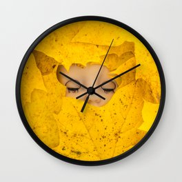 Moody, sleeping doll in vibrant yellow maple leaves Wall Clock