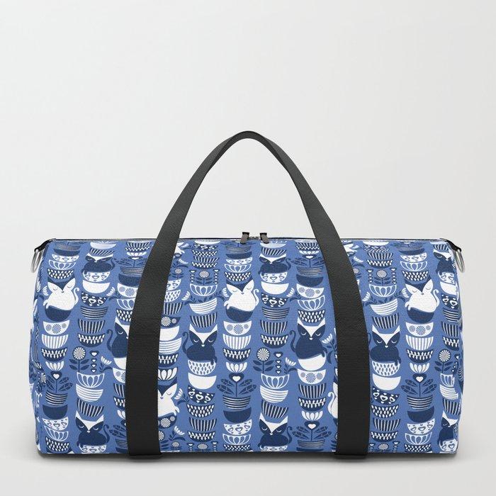 Swedish folk cats I // Indigo blue background Duffle Bag