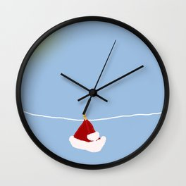 santa hat on clothesline Wall Clock