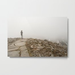 Person standing in fog on peak Metal Print