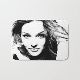 High contrast black and white portrait of beautiful girl with fluttering hair and open eyes. Bath Mat