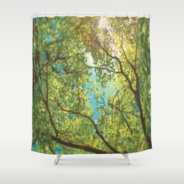 Canopy of trees with sun beaming through in vivid green and blue Shower Curtain