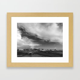 Airliner taxiing on a runway Framed Art Print