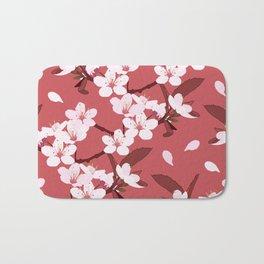 Sakura on red background Bath Mat
