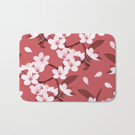 Sakura on red background Bath Mat