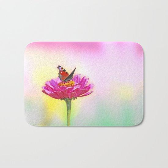 Butterfly landing on pink flower Bath Mat