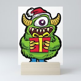 CUTE CHRISTMAS MONSTER WITH PRESENT Mini Art Print