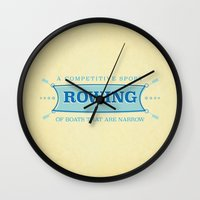 sport Wall Clocks featuring A Competitive Sport. by Rabassa