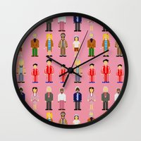 the royal tenenbaums Wall Clocks featuring The Royal Pixelbaums by Isabel