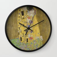 gustav klimt Wall Clocks featuring The Kiss - Gustav Klimt by Elegant Chaos Gallery