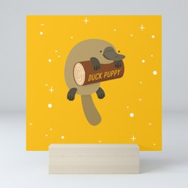 """Duck puppy"" platypus with a log (yellow) Mini Art Print"